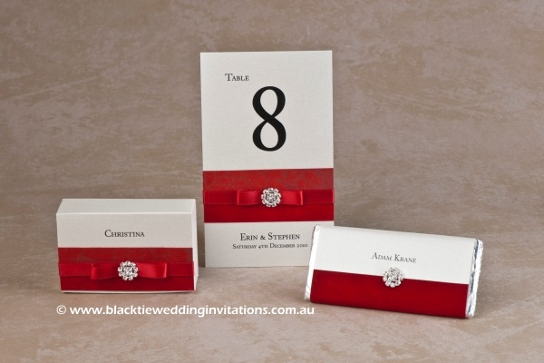 red - favour box, table number and personalised chocolate